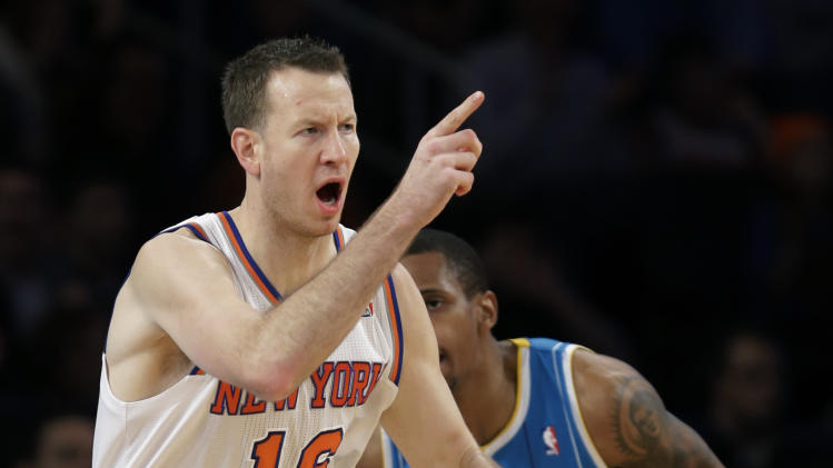 New York Knicks forward Steve Novak (16) reacts in front of New Orleans Hornets forward Lance Thomas (42) after hitting a three-point basket in the second half of the Knicks' 100-87 victory in an NBA basketball game at Madison Square Garden in New York, Sunday, Jan. 13, 2013. (AP Photo/Kathy Willens)