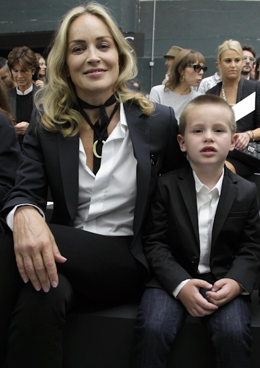 Sharon Stone and her son Quinn Kelly Stone attend the show of Belgian fashion designer Kris Van Assche for Dior as part of the Men's Spring-Summer 2013 collection, for the Paris Fashion Week, in P