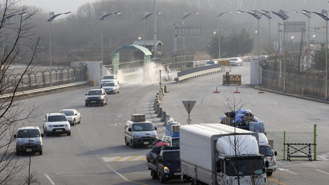 South Korean vehicles return from the North Korean city of Kaesong at the customs, immigration and quarantine office in Paju, South Korea, near the border village of Panmunjom, Thursday, April 4, 2013. North Korea on Wednesday barred South Korean workers from entering a jointly run factory park just over the heavily armed border in the North, officials in Seoul said, a day after Pyongyang announced it would restart its long-shuttered plutonium reactor and increase production of nuclear weapons material. (AP Photo/Ahn Young-joon)