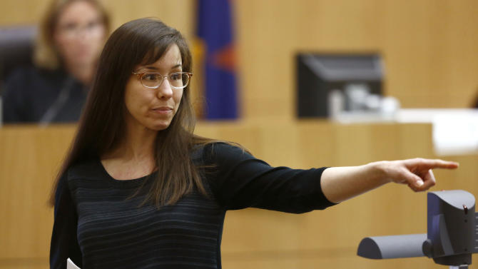 FILE - In this May 21, 2013 file photo, Jodi Arias points to her family as a reason for the jury to give her a life in prison sentence instead of the death penalty, during the penalty phase of her murder trial at Maricopa County Superior Court in Phoenix. As she awaits a decision by prosecutors on the future of her murder case, Arias and her attorneys are returning to court Tuesday, July 16, 2013 to ask the judge to throw out the jury's finding that made her eligible for the death penalty. (AP Photo/The Arizona Republic, Rob Schumacher, Pool, File)