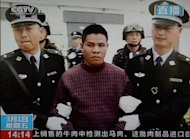 This frame grab taken from Chinese television CCTV on March 1, 2013, shows convicted murderer Zha Xika of Laos being led from his prison cell as he is transferred for execution in Yunnan Province.