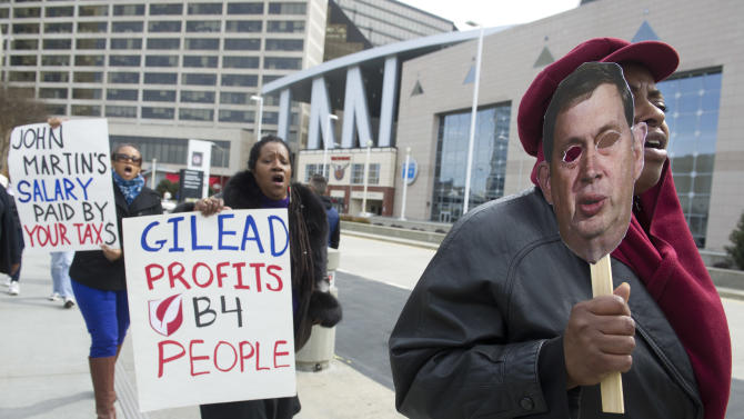 IMAGE DISTRIBUTED FOR AIDS HEALTHCARE FOUNDATION - Vicki Reid, right, holds a likeness of Gilead pharmaceutical company CEO John Martin, while protesting high drug prices with others from the Atlanta Drug Pricing Forum, in front of the Conference on Retroviruses and Opportunistic Infections (CROI) going on at the World Congress Center in Atlanta, Monday, March 4, 2013. AIDS Healthcare Foundation has joined with Citywide Project and HCV Coalition for the Cure to host the two day forum. (John Amis/AP Images for AIDS Healthcare Foundation)