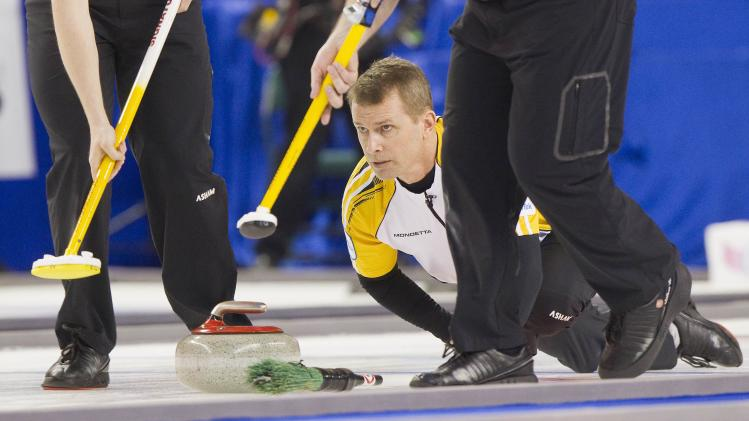 Team Manitoba skip Jeff Stoughton delivers a stone against team Quebec during the 2014 Tim Hortons Brier curling championships in Kamloops