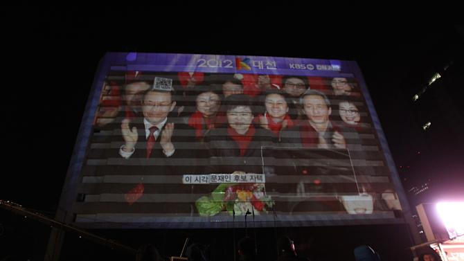 A huge screen shows South Korea's presidential candidate Park Geun-hye, center, of ruling Saenuri Party in Seoul, South Korea, Wednesday, Dec. 19, 2012. (AP Photo/Ahn Young-joon)