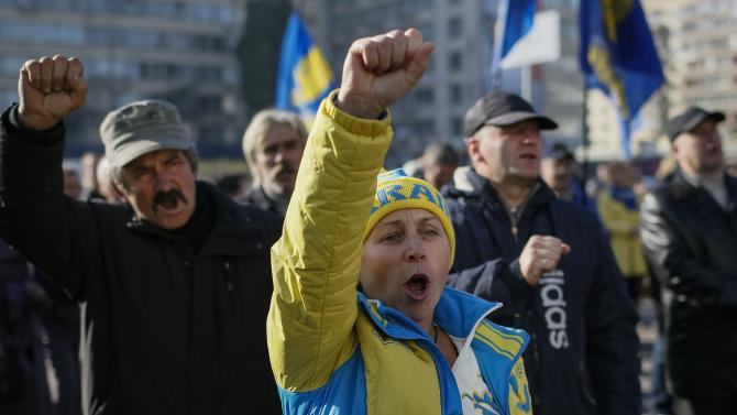 Activists and supporters of the All-Ukrainian Union Svoboda (Freedom) right Party attend a rally in front of the Ukrainian Central Elections Commission in Kiev