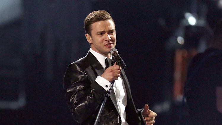 "FILE - This Feb. 20, 2013 file photo shows Justin Timberlake during the BRIT Awards 2013 in London.  Timberlake's ""Suit & Tie,"" was the top streamed track on Spotify from Monday, March 18, to Sunday, March 24. (Photo by Joel Ryan/Invision/AP, file)"