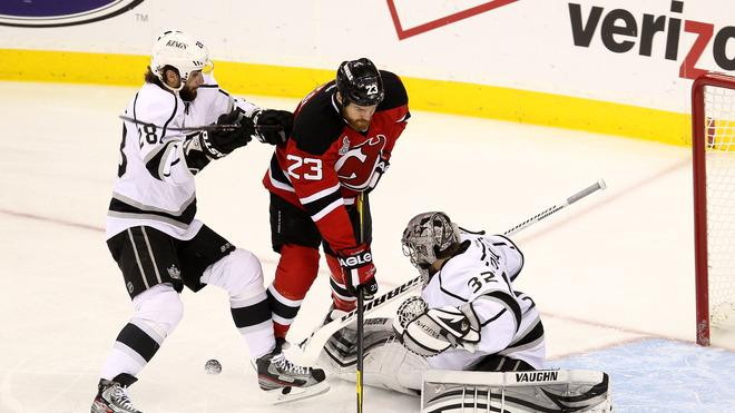 Jarret Stoll #28 Of The Los Angeles Kings And David Clarkson #23 Of The New Jersey Devils Fight For A Loose Puck In  Getty Images