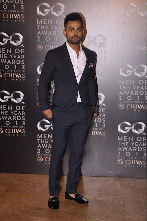 Indian cricket player Virat Kholi during the GQ India Man of the year Award ceremony in Mumbai on September 29, 2013. (Photo: IANS)