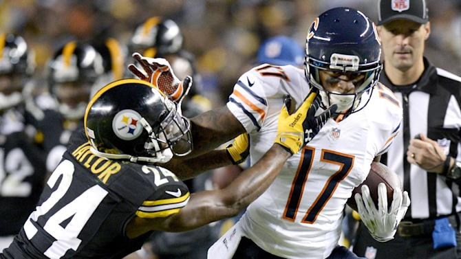 Chicago Bears wide receiver Alshon Jeffery (17) is hit by Pittsburgh Steelers cornerback Ike Taylor (24) after making a catch in the third quarter of an NFL football game on Sunday, Sept. 22, 2013, in Pittsburgh. (AP Photo/Don Wright)