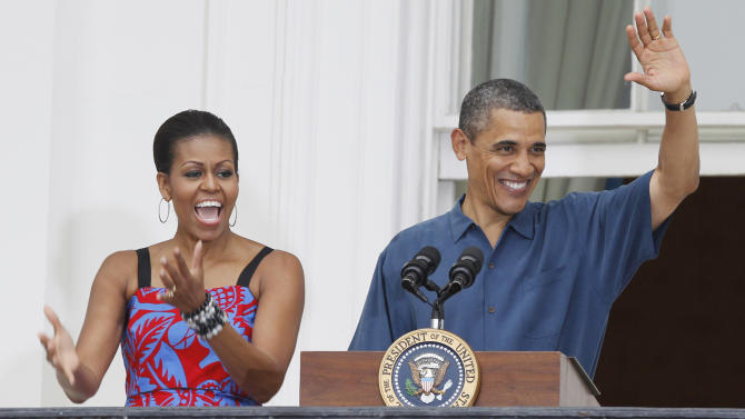 President Barack Obama and first lady Michelle Obama welcome military families to an Independence Day celebration on the South Lawn of the White House in Washington, Monday, July 4, 2011. (AP Photo/Charles Dharapak)