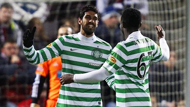 eltic's Lassad Nouioui (L) celebrates with teammate Victor Wanyama after scoring against Hearts