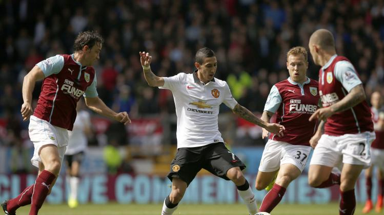 Manchester United's Di Maria is challenged by Burnley's Trippier and Arfield during their English Premier League soccer match at Turf Moor in Burnley
