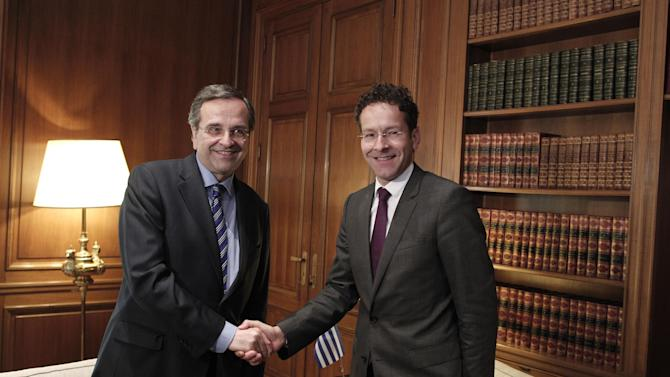 Greek Prime Minister Antonis Samaras, left, and Jeroen Dijsselbloem, who heads the finance ministers of the 17 European Union countries that use the euro, pose for photographers prior to their meeting in Athens, Friday, May 31, 2013. Dijsselbloem, is meeting in Athens with the Greek prime minister and finance minister to discuss the debt-ridden country's efforts to reform its economy. (AP Photo/Petros Giannakouris)