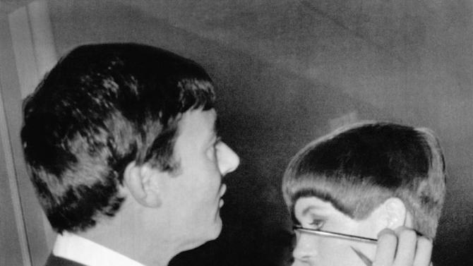 FILE - In this Jan. 11, 1966 file photo, hair stylist Vidal Sassoon gives New York model Holly McGuire a close-cropped hairdo at a preview of the New York Couture Group styles in New York.  Sassoon, whose 1960s wash-and-wear cuts freed women from endless teasing and hairspray died Wednesday, May 9, 2012, at his home. He was 84. (AP Photo, file)