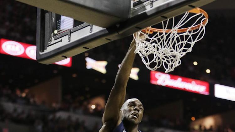 Memphis Grizzlies' Quincy Pondexter dunks against San Antonio Spurs' Boris Diaw (33), of France, during the second half in Game 2 of the Western Conference finals NBA basketball playoff series, Tuesday, May 21, 2013, in San Antonio. (AP Photo/Eric Gay)