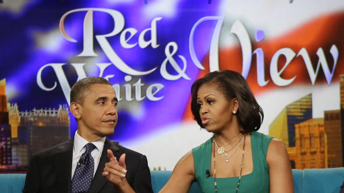 "President Barack Obama and first lady Michelle Obama appear on the ABC Television show ""The View"" in New York, Monday, Sept. 24, 2012. (AP Photo/Pablo Martinez Monsivais)"