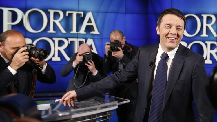 "Italy's Prime Minister Matteo Renzi smiles as Italian journalist and host Bruno Vespa takes a picture during television talk show ""Porta a Porta"" (Door to Door) in Rome"