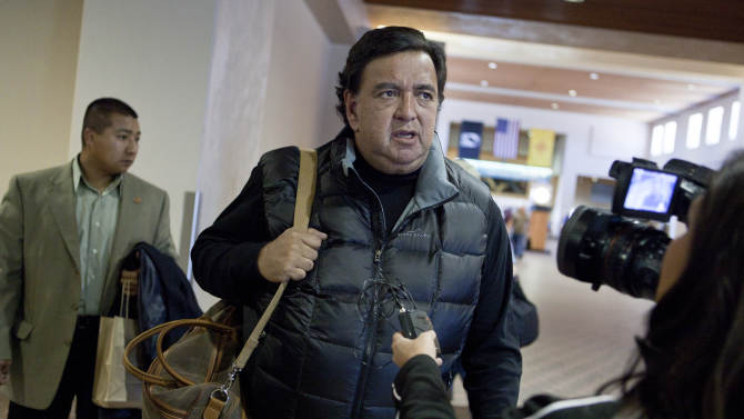 New Mexico Gov. Bill Richardson stops to talk with a reporter at the Albuquerque airport on his way to North Korea on Tuesday, Dec. 14, 2010. The State Department says Richardson isn't delivering a message for the U.S. government. However, Richardson's contacts with North Korean officials may provide insights for diplomats trying to persuade North Korea to abandon its nuclear weapons program. (AP Photo/Craig Fritz)