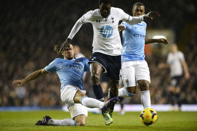 Tottenham Hotspur's Adebayor is challenged by Manchester City's Demechelis during their English Premier League soccer match at White Hart Lane in London