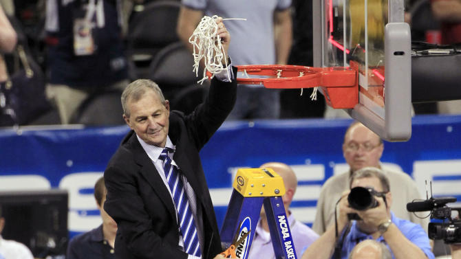 FILE - In this April 4, 2011, file photo, Connecticut head coach Jim Calhoun holds the net after his team defeated Butler 53-41 to win the men's NCAA Final Four college basketball championship game in Houston. Calhoun is expected to announce his retirement on Thursday, Sept. 13, 2012, according to a person familiar with the situation. (AP Photo/Mark Humphrey, File)