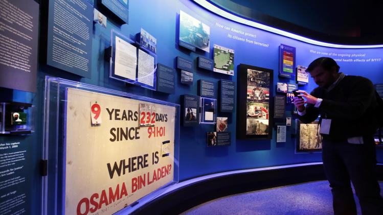 FILE- In this May 14, 2014 file photo, a sign tracking the time Osama Bin Laden was at large is displayed at the National Sept. 11 Memorial Museum in New York. The museum is the latest in a series of memorials-as-museums that seek to honor the dead while presenting a full, fair history of the event that killed them. And the Sept. 11 museum strives to do that at ground zero while the attacks are still raw memories for many. (AP Photo)