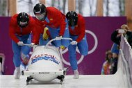 Russia's pilot Alexander Zubkov (front) and his teammates start a run during a four-man bobsleigh training session at the Sanki Sliding Center in Rosa Khutor, during the Sochi 2014 Winter Olympics February 19, 2014. REUTERS/Murad Sezer