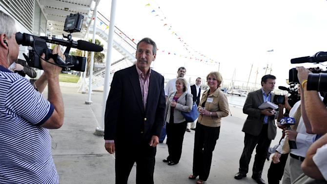 Former South Carolina Gov. Mark Sanford, center, arrives during a campaign stop at the Charleston Maritime Center on Tuesday, April 30, 2013 in Charleston, S.C. (AP Photo/Rainier Ehrhardt)