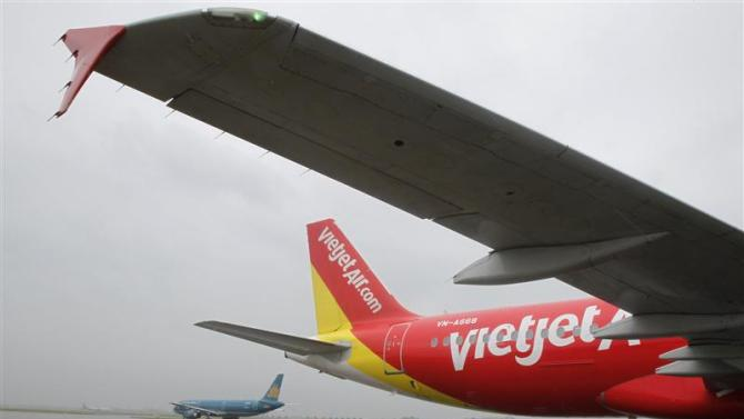 A VietJet A320 airplane is seen while parking before departure for Bangkok at Noi Bai international airport in Hanoi