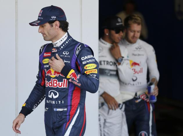 Red Bull Formula One driver Webber of Australia walks after taking pole position after the qualifying session of the Japanese F1 Grand Prix at the Suzuka circuit