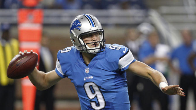 Detroit Lions quarterback Matthew Stafford (9) throws against the Jacksonville Jaguars in the first half of a preseason NFL football game at Ford Field in Detroit, Friday, Aug. 22, 2014. (AP Photo/Duane Burleson)