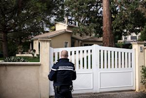 A French police officer patrols in front of the home …