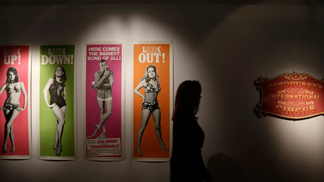 A compete set of four original Thunderball movie posters produced for the United States in 1965, right, and an Octopussy Circus sign are seen on view at the James Bond movie memorabilia charity auction. The four Thunderball posters are expected to sell for some 6-8,000 British pounds, ($ 9100-12000 euro 6800-9000) that will go to UNICEF.