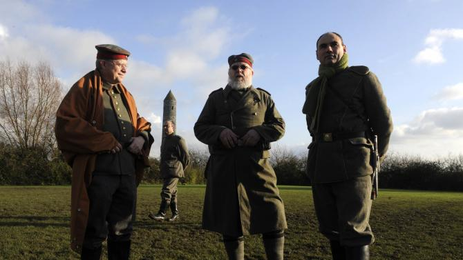 Figurants stand in a field prior to a soccer match to mark the centenary of the legendary football match between the German and Allied troops on the Western Front during the Christmas Truce of 1914, at the Flanders Peace Field in Mesen