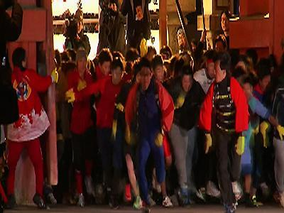 Raw: Runners Dash Through Japan Shrine for Luck