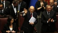 Italy's newly re-elected president Giorgio Napolitano (C) waves at the end of his speech flanked by lower house President Laura Boldrini (L) and her upper house counterpart Pietro Grasso at the lower house of the parliament in Rome, April 22, 2013. REUTERS/Tony Gentile