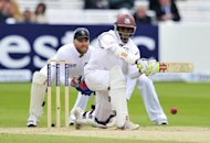 West Indies' cricketer Shivnarine Chanderpaul plays a low cut during the fourth day of the first Test against England at Lords cricket ground in London, May 20. England will take an unbeatable lead in their three-match series against the West Indies if they win the second Test at Trent Bridge starting on Friday
