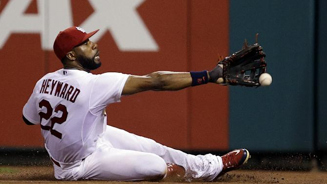 St. Louis Cardinals right fielder Jason Heyward cannot catch a ball hit for a ground-rule double by San Diego Padres' Clint Barmes during the 11th inning of a baseball game Thursday, July 2, 2015, in St. Louis. (AP Photo/Jeff Roberson)