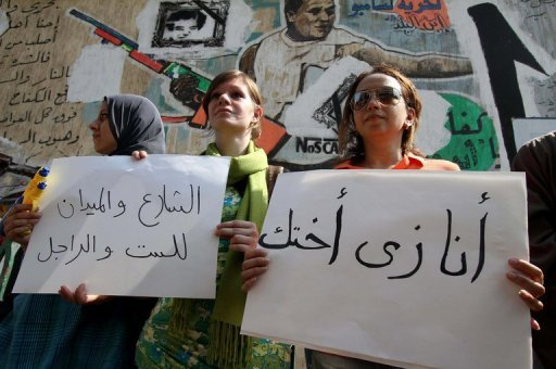 "Protesters hold signs reading ""I am like your sister"" (right) and ""The streets and the square are for women and men"" during a demonstration in Cairo against sexual harassment. Egyptian women are speaking up against sexual violence after harrowing tales of mob attacks in Cairo's iconic Tahrir Square prompted initiatives to combat the ""epidemic."""