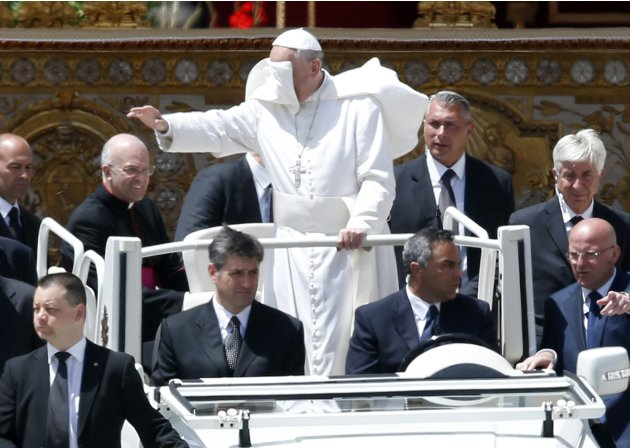 A gust of wind blows Pope Francis' mantle as he leaves at the end of a mass in Saint Peter's Square at the Vatican
