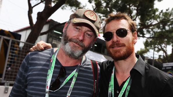 Actors Liam Cunningham and Michael Fassbender are seen on the grid before the Monaco Formula One Grand Prix at the Circuit de Monaco on May 27, 2012 in Monte Carlo, Monaco. (Photo by Mark Thompson/Getty Images)