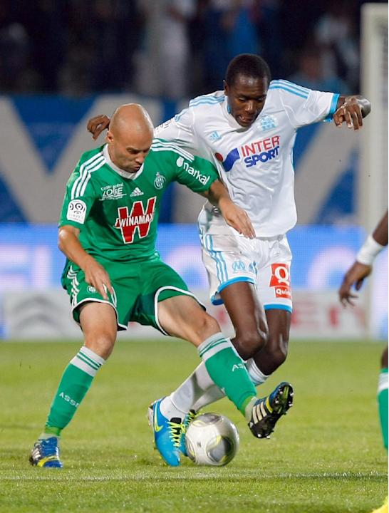 Marseille's French midfielder Giannelli Imbula, right, challenges for the ball with Saint-Etienne's French midfielder Fabien Lemoine during their League One soccer match at the Velodrome Stadium, in M