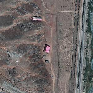 In this satellite image supplied Friday Aug. 24, 2012, by the Institute for Science and International Security (ISIS),  showing what they say are buildings, seen here at centre and top, shrouded with a pink tarp to stop the U.N nuclear agency from monitoring Tehran's efforts to sanitize the site which they suspect was used for secret work on atomic weapons, in this photo dated Aug. 15, 2012, of the Parchin military complex southeast of Tehran, Iran. Other photos taken at an earlier date, appear to show the same buildings, without a tarp but with what looks like the results of extensive alterations undertaken at the suspected high explosives testing site, including the demolition of two nearby buildings and major earth displacement activities nearby, diplomats told The Associated Press on Friday Aug. 24, 2012. The information on the shrouding of the building came from two diplomats who demanded anonymity because they were not authorized to discuss the confidential satellite images. (AP Photo/ISIS)