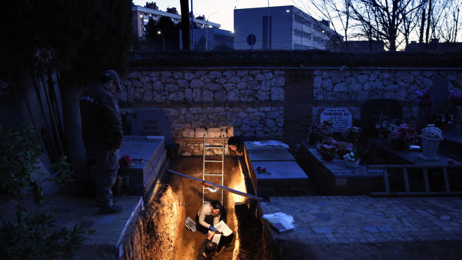 Members of the Association for the Recovery of Historical Memory take part in the exhumation of the grave in Guadalajara's cemetery