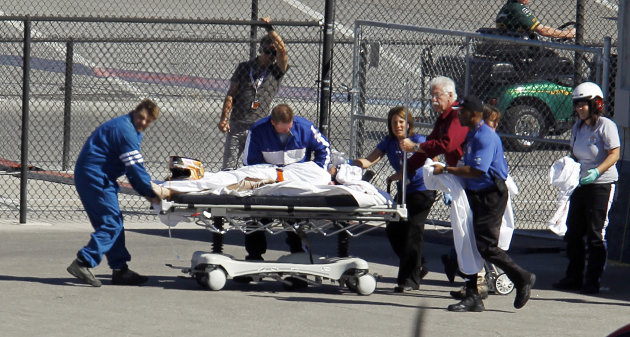 Dan Wheldon, of England, is transported to a medical helicopter following a crash early in the IndyCar Series&#39; Las Vegas Indy 300 auto race Sunday, Oct. 16, 2011, in Las Vegas. (AP Photo/Isaac Brekken)