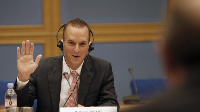 The head of the U.S. Anti-Doping Agency (USADA), Travis Tygart, takes an oath prior to answering questions before a senate-led inquiry into the fight against doping in Paris, France, Thursday, April 25, 2013. The hearings are aimed at looking into ways of improving the fight against doping. USADA'S report produced a scathing report detailing systematic doping by Lance Armstrong and his teams, which led to Armstrong being stripped of his seven Tour titles and banned from elite sport for life. (AP Photo/Francois Mori)