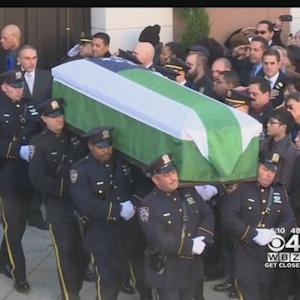 Police Departments Attend Funeral Of Slain NYPD Officer