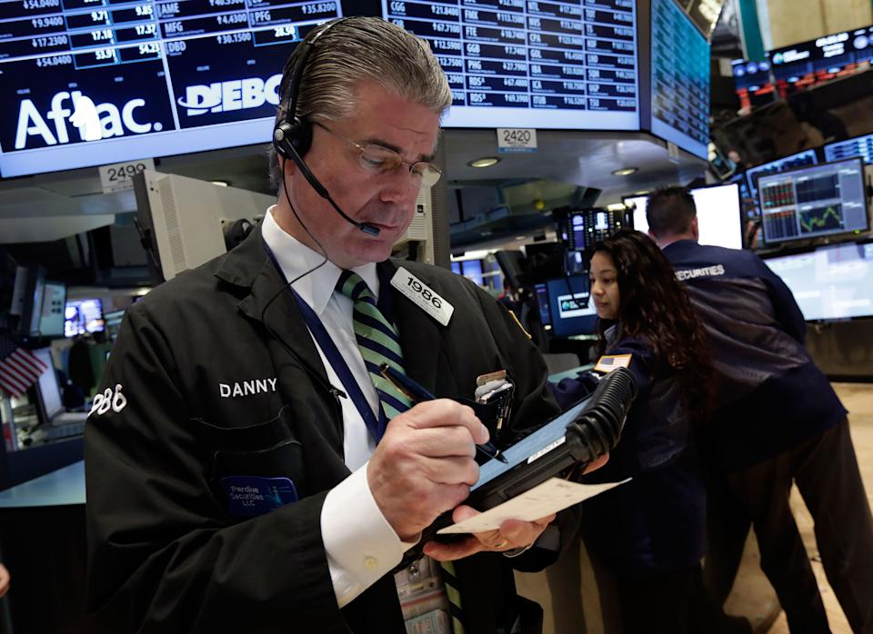 Trader Daniel Kryger works on the floor of the New York Stock Exchange Tuesday, April 30, 2013. Stock prices are opening mostly lower on Wall Street as weak earnings from Pfizer and other companies drag down major market averages. (AP Photo/Richard Drew)