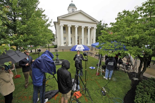 Reporters work on the front lawn of the Centre County Courthouse in Bellefonte, Pa., Monday, June 4, 2012, a day before the start of the child sexual abuse trial of former Penn State college football