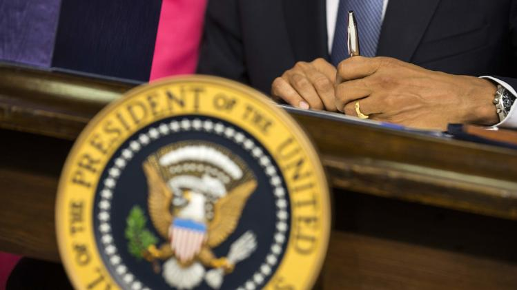 U.S. President Barack Obama signs the Workforce Innovation and Opportunity Act at the White House in Washington