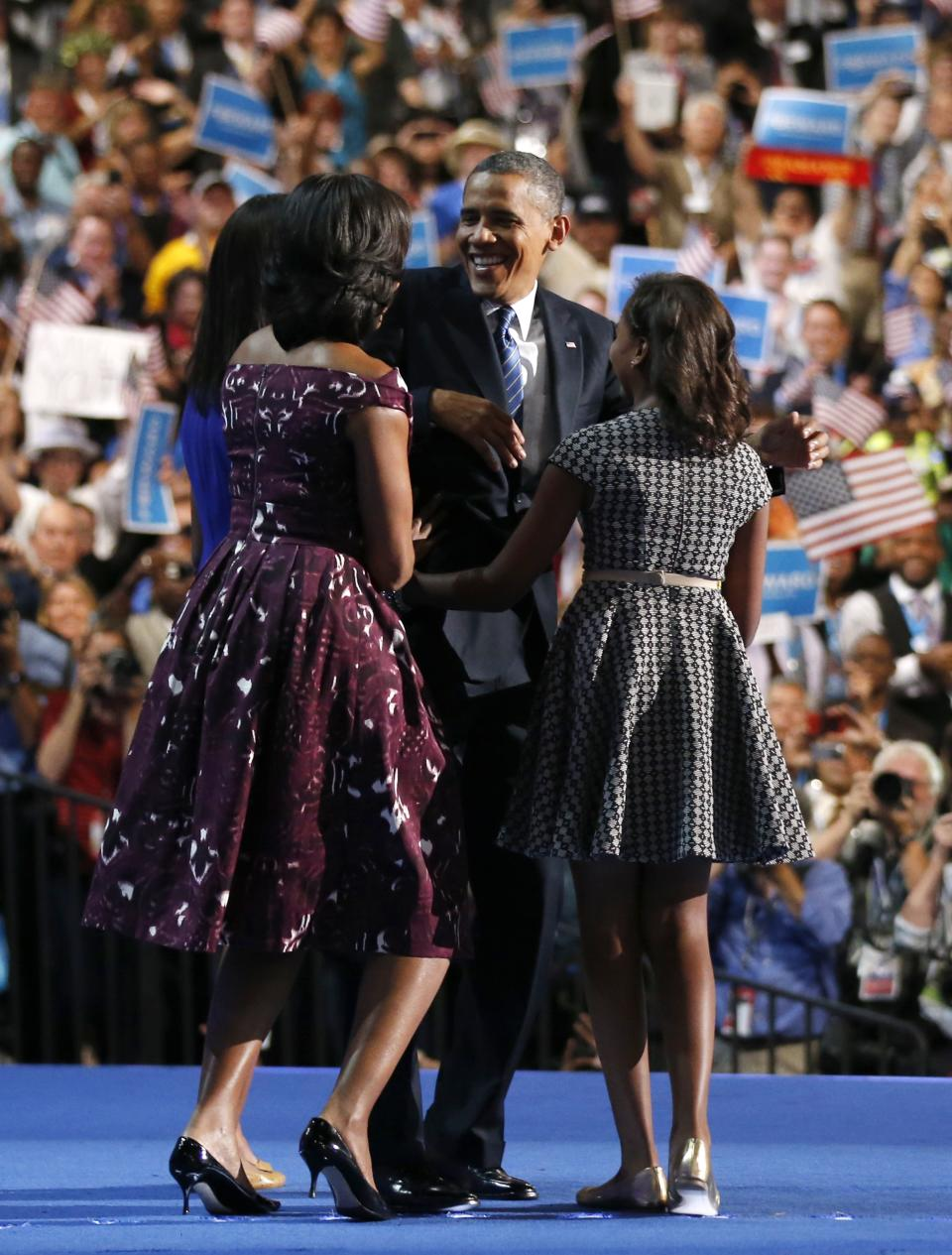 President Barack Obama is joined on stage by first lady Michelle Obama, left, their children Malia and Sasha, right, on the final day of the Democratic National Convention in Charlotte, N.C., Thursday, Sept. 6, 2012. (AP Photo/Jae C. Hong)